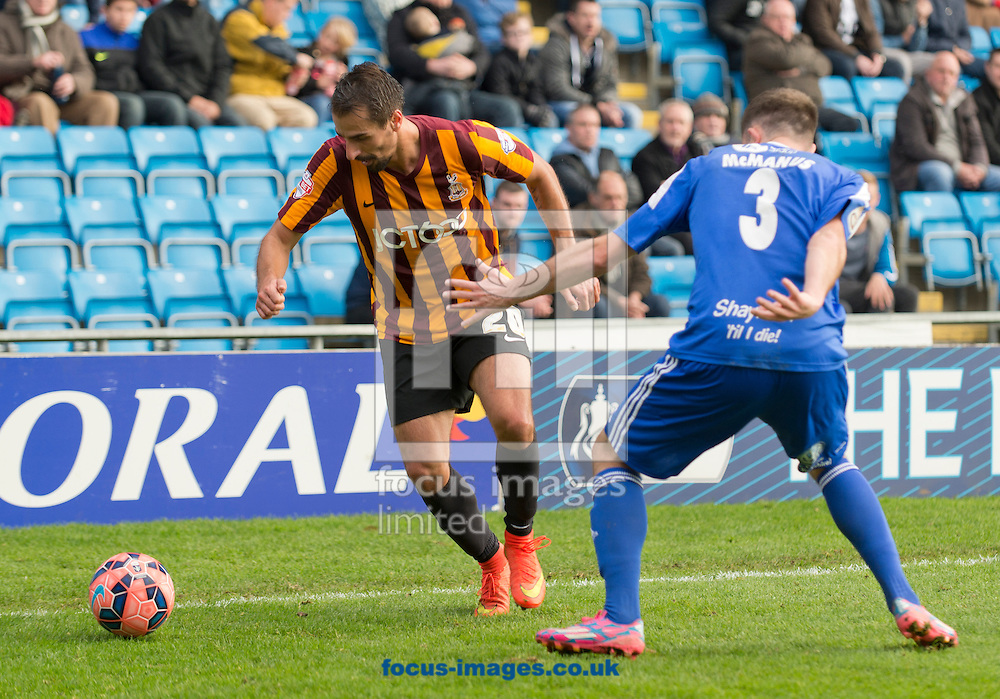 Filipe Morais of Bradford City turns outside Scott McManus of FC Halifax Town during the The FA Cup match at Shay Stadium, Halifax<br /> Picture by Russell Hart/Focus Images Ltd 07791 688 420<br /> 09/11/2014