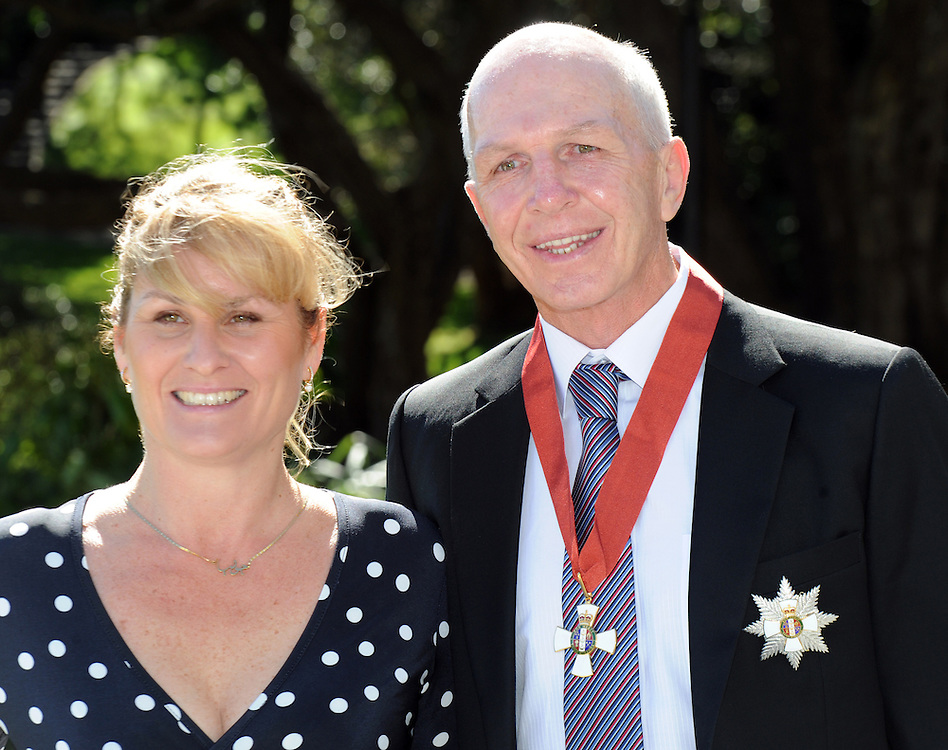 New Zealand rugby Sevens coach Sir Gordon Tietjens, right, with his wife Julia, after receiving his Knight Companion of the New Zealand Order of Merit from the Governor General Sir Jerry Mateparae, Government House, Wellington, New Zealand, Monday, September 16, 2013. Credit:SNPA / Ross Setford