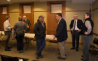 Former Mayor Rod Dyer, Mayor Ed Engler and former Mayor Matt Lahey chat with members from the audience following the Laconia Mayors Symposium at the Laconia Library Tuesday evening.  (Karen Bobotas/for the Laconia Daily Sun)
