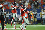 Ole Miss Rebels linebacker Keith Lewis (24) celebrates a tackle with Ole Miss Rebels defensive back Trae Elston (7) and Ole Miss Rebels defensive back Mike Hilton (28) vs. Boise State at the Georgia Dome in Atlanta, Ga. on Thursday, August 28, 2014. Ole Miss won 35-13.