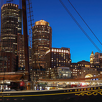 Boston panorama photography of Sail Boston tall ship Roseway moored at Fan Pier in the Boston Harbor with waterfront skyline photography from New England photographer Juergen Roth. The image shows the historic sailboat in front of the Boston Financial Waterfront District landmarks such as the Custom House of Boston, One International Place, Boston Harbor Hotel photographed on a beautiful summer sunset evening. <br /> <br /> Sail Boston photos are available as museum quality photo prints, canvas prints, wood prints, acrylic prints or metal prints. Fine art prints may be framed and matted to the individual liking and decorating needs:<br /> <br /> https://juergen-roth.pixels.com/featured/sail-boston-tall-ship-roseway-juergen-roth.html<br /> <br /> All digital Boston tall ships photography images are available for photo image licensing at www.RothGalleries.com. Please contact me direct with any questions or request.<br /> <br /> Good light and happy photo making!<br /> <br /> My best,<br /> <br /> Juergen<br /> Prints: http://www.rothgalleries.com<br /> Photo Blog: http://whereintheworldisjuergen.blogspot.com<br /> Instagram: https://www.instagram.com/rothgalleries<br /> Twitter: https://twitter.com/naturefineart<br /> Facebook: https://www.facebook.com/naturefineart