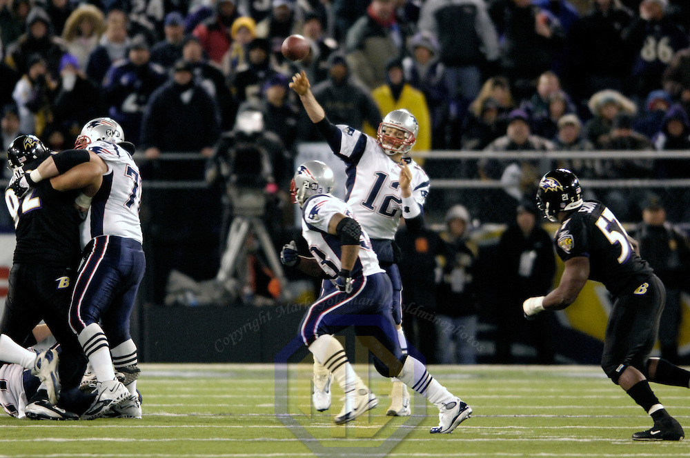 New England Patriots quarterback Tom Brady (12) throws a 23-yard pass in the 4th quarter against the Baltimore Ravens on December 3, 2007 at M&T Bank Stadium in Baltimore, Maryland.  The Patriots defeated the Ravens 27-24.
