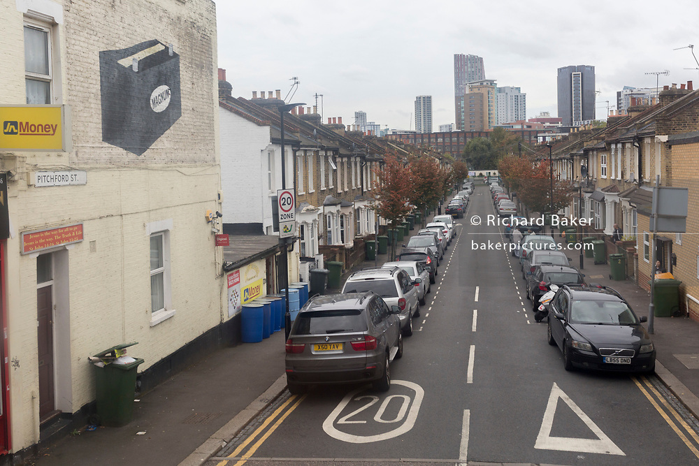 An aerial landscape of cars parked on both sides of the residential Pitchford Street E15, a 20mph zone in Stratford, on 8th October 2019, in Rainham, Essex, England.