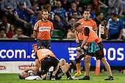 Johnny McNicholl of the BNZ Crusaders is attended to by the team doctors during the Canterbury Crusaders v the Western Force Super Rugby Match. Nib Stadium, Perth, Western Australia, 8th April 2016. Copyright Image: Daniel Carson / www.photosport.nz