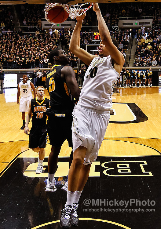 WEST LAFAYETTE, IN - JANUARY 27: A.J. Hammons #20 of the Purdue Boilermakers dunks the ball against Anthony Clemmons #5 of the Iowa Hawkeyes at Mackey Arena on January 27, 2013 in West Lafayette, Indiana. Purdue defeated Iowa 65-62 in overtime. (Photo by Michael Hickey/Getty Images) *** Local Caption *** A.J. Hammons; Anthony Clemmons