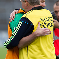 Clare's Donal Moloney and Limerick's Paul Kinnerk embrace at the final whistle