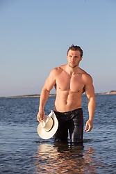 shirtless cowboy in the bay on a Summer day