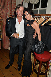 RICHARD CARING and NANCY DELL'OLIO at a party to celebrate 35 years of Harry's Bar, 26 South Audley Street, London on 19th September 2014.