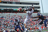 A pass is incomplete to Evan Engram (17) as Deterrian Shackelford (38) at Mississippi's Grove Bowl controlled scrimmage at Vaught-Hemingway Stadium in Oxford, Miss. on Saturday, April 5, 2014. (AP Photo/Oxford Eagle, Bruce Newman)