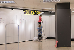 © Licensed to London News Pictures. 28/08/2016. London, UK. Staff remove signage from the BHS store in Harrow, in north west London.  The Harrow store is one of the remaining 22 stores which closed for the last time today,  Shelves, fixtures and fittings are being sold as well as the last remaining stock.  After administrators, failed to find a suitable buyer for the department store chain, the decision was made to close all 164 shops, with the loss of 11,000 jobs. Photo credit : Stephen Chung/LNP