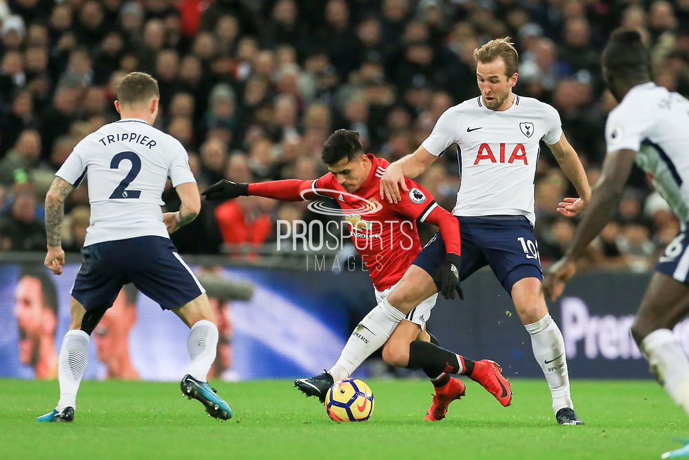 Harry Kane of Tottenham Hotspur tackles Manchester United Forward Alexis Sanchez during the Premier League match between Tottenham Hotspur and Manchester United at Wembley Stadium, London, England on 31 January 2018. Photo by Phil Duncan.