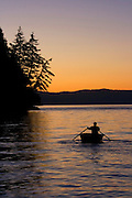 Rowing boat at sunset, San Juan Islands, Washington State