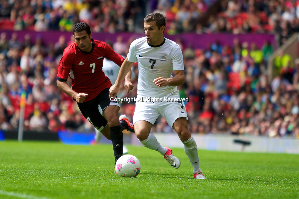 29.07.2012 Manchester, England. New Zealand forward Kosta Barbarouses and Egypt defender Ahmed Fathy in action during the first round group C mens match between Egypt and New Zealand.