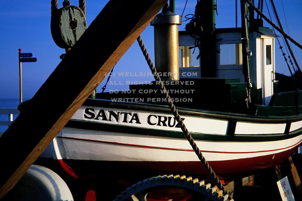 "Image from the Santa Cruz Wharf of a boat named ""Santa Cruz"" on the central California coast"