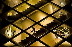 Night view of modern  glass walled Prada store in Toyama Tokyo Japan