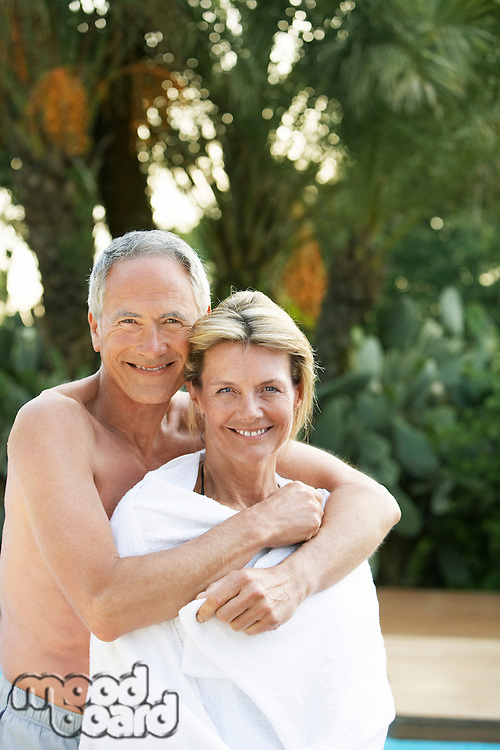 Affectionate Senior Couple at Poolside