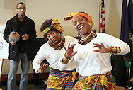 Middletown, New York  - Dancers with Maxwell Kofi Donkor and the Sankofa Drum and Dance Ensemble, and a member of the audience at left,  perform at Thrall Library on Feb. 26, 2012.