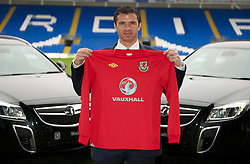 CARDIFF, WALES - Wednesday, January 12, 2011: Wales' manager Gary Speed photographed next to Vauxhall cars during the announcement that British car manufacturer Vauxhall is to become the official leading sponsorship partner to the Wales international football teams, at Cardiff City Stadium. (Pic by: David Rawcliffe/Propaganda).+++ THIS IMAGE IS FREE TO USE IN CONJUNCTION WITH EDITORIAL OF VAUXHALL'S SPONSORSHIP OF THE FAW. +++