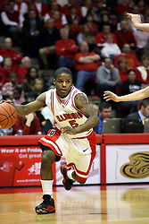 "12 January 2008: Keith ""Boo"" Richardson charges from right to left along the baseline during a game in which  the Purple Aces of the University of Evansville lost to  the Redbirds of Illinois State on Doug Collins Court at Redbird Arena in Normal Illinois by a score of 74-66."