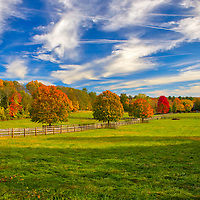 Farmland in Sherborn, Massachusetts in Middlesex County showing brilliant fall foliage colors within a beautiful farm setting on a picture perfect late afternoon. During the 2017 New England fall foliage season I decided to stay mostly local and rediscover local areas and landmarks. Glad about that call and I sure will do more of that in the future. <br />