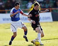 Photo: Chris Ratcliffe.<br />Barnet FC v Carlisle United. Coca Cola League 2. 25/02/2006.<br />Giuliano Grazioli of Barnet (R) gets away from Paul Arnison of Carlisle.