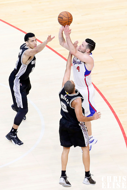 19 April 2014: Los Angeles Clippers guard J.J. Redick (4) takes a jump shot over San Antonio Spurs guard Tony Parker (9) and San Antonio Spurs guard Danny Green (14) during the Los Angeles Clippers 107-92 victory over the San Antonio Spurs, during Game One of the Western Conference Quarterfinals of the NBA Playoffs, at the Staples Center, Los Angeles, California, USA.