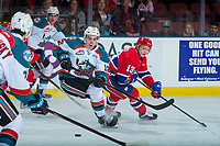 KELOWNA, CANADA - MARCH 3: Erik Gardiner #12 of the Kelowna Rockets skates with the puck ahead of Riley Woods #13 of the Spokane Chiefs on March 3, 2018 at Prospera Place in Kelowna, British Columbia, Canada.  (Photo by Marissa Baecker/Shoot the Breeze)  *** Local Caption ***