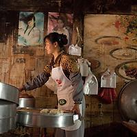 Morning steamed bun seller near the center of Heshun old town.