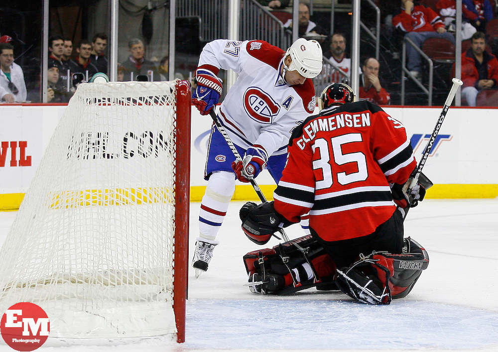 Jan 21, 2008; Newark, NJ, USA; New Jersey Devils goalie Scott Clemmensen (35) makes a save on Montreal Canadiens right wing Alexei Kovalev (27) during the first period at the Prudential Center.