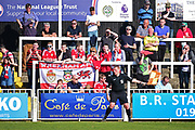 Wrexham supporters enjoy the sunshine during the Vanarama National League match between Bromley FC and Wrexham FC at Hayes Lane, Bromley, United Kingdom on 8 April 2017. Photo by Jon Bromley.