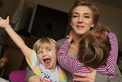 Children making funny faces with mother