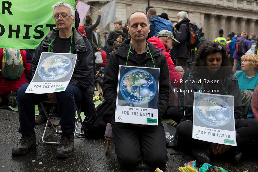 Environmental activists protest about Climate Change during the blockade at the junction at Bank in the heart of the capital's financial district, the City of London aka the Square Mile, on the seventh day of a two-week prolonged worldwide protest by members of Extinction Rebellion, on 14th October 2019, in London, England.