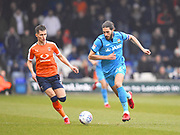Barnet captain Dan Sweeney moves the ball down the field in the first half during the EFL Sky Bet League 2 match between Luton Town and Barnet at Kenilworth Road, Luton, England on 24 March 2018. Picture by Ian  Muir.