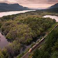 A train speeds past the vast Colombia River Gorge.
