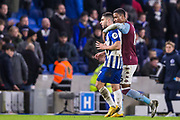 Neal Maupay (Brighton) attempts to remove the embrace from Ezri Konsa (Aston Villa) as both players went to leave the pitch following the final whistle after the Premier League match between Brighton and Hove Albion and Aston Villa at the American Express Community Stadium, Brighton and Hove, England on 18 January 2020.