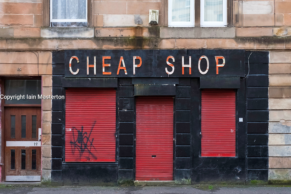 Small shuttered shop in Govanhill district of Glasgow, Scotland, United Kingdom.