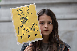 "© Licensed to London News Pictures. 24/07/2017. LONDON, UK. Primary school children from Barnet take part in a ""Don't lock us out of our library"" protest outside the offices of the Department for Culture, Media and Sport in Westminster, delivering 440 postcards addressed to Karen Bradley, the Culture Secretary, demanding a reinstatement of independent access to libraries. Public libraries in Barnet have been shut and are now reopening with restricted access and opening hours, making the service less accessible to vulnerable members of the community. Photo credit: Vickie Flores/LNP"