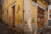 Student graffiti on a street corner near Coimbra university, Portugal.