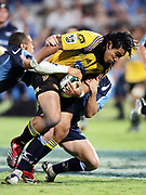 Hurricanes centre Ma'a Nonu charges ahead during the Super 14 rugby union match between the Bulls and Hurricanes at Loftus Pretoria, South Africa, on Friday 17 March, 2006. The Hurricanes won the match 26-23. Photo: Africa Visuals/PHOTOSPORT **NZ USE ONLY**<br /> <br /> <br /> 149905