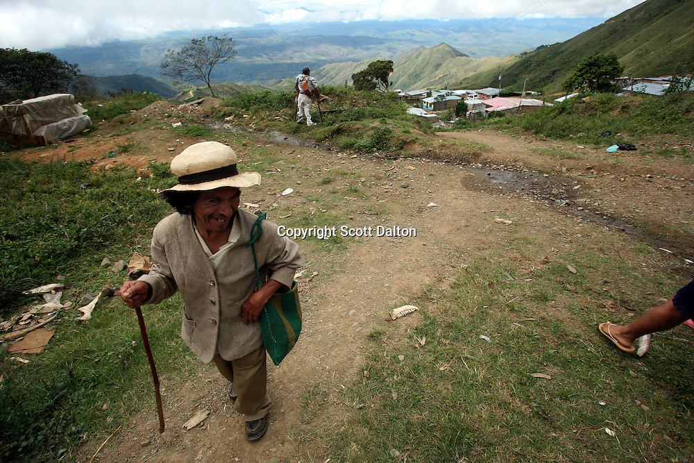 A man walks to the market in Leiva, a small remote village in the southern Colombian state of Nariño, on June 24, 2007. The area around Leiva has long been a coca-producing region; most of the people who live in the area have relied on the coca business in order to make ends meet. But with increasing pressure by the Colombian government, with fumigation and manual eradication of the coca fields, many people are now trying to figure out what the will do if they can?t rely on their meager coca profits. (Photo/Scott Dalton)