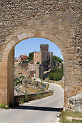 Alarcon, Spain. The Parador seen through a fortification on the way into the town.