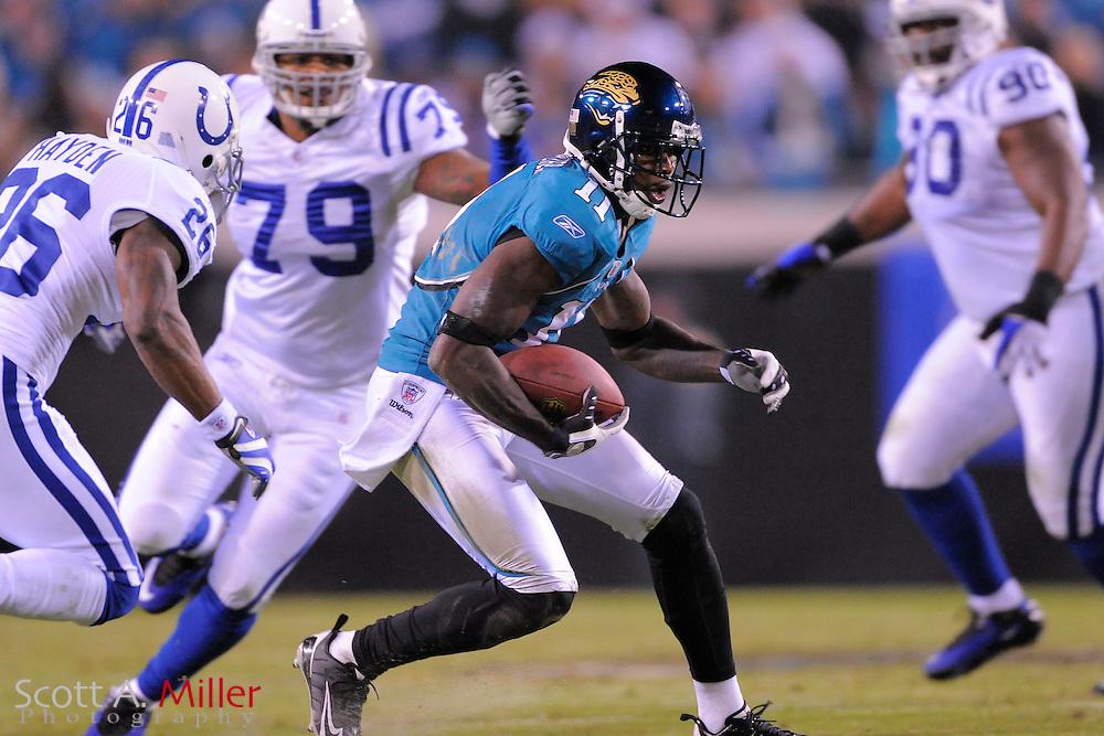 Dec. 17, 2009; Jacksonville, FL, USA; Jacksonville Jaguars wide receiver Mike Sims-Walker (11) in action against the Indianapolis Colts at Jacksonville Municipal Stadium. The Colts won. 35-31. ©2009 Scott A. Miller.© 2009 Scott A. Miller