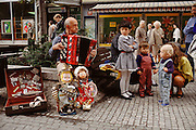 Street performer and children in the old town. Prague, Czech Republic.