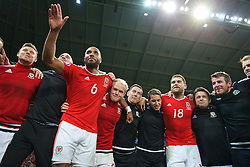LILLE, FRANCE - Friday, July 1, 2016: Wales players celebrate in the team huddle following a 3-1 victory over Belgium and reaching the Semi-Final during the UEFA Euro 2016 Championship Quarter-Final match at the Stade Pierre Mauroy. captain Ashley Williams, Jonathan Williams, masseur David Rowe, Adam Owen, Sam Vokes, physiotherapist David Weeks, Ronan Kavanagh. (Pic by David Rawcliffe/Propaganda)