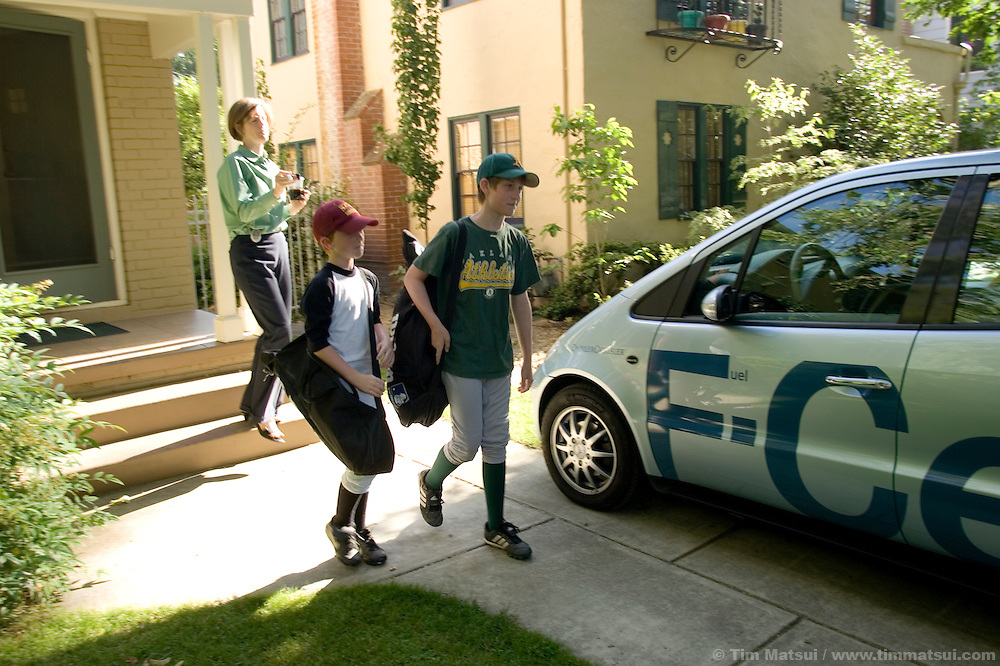 TUESDAY JUNE 20, 2006 - SACRAMENTO, CA  Catherine Dunwoody, Executive Director of the California Fuel Cell Partnership (CAFCP), uses a Diamler-Chrysler fuel cell vehicle (FCV) to take her sons Adam, 9, and Nathan, 12, to baseball camp in Sacramento, CA, on Tuesday, June 20, 2006. The FCV is a fleet vehicle on loan from Daimler-Chrsyler which every CAFCP employee drives for a week as part of the partnership's outreach program and to allow the company to test real-world application of its technology...The CAFCP is a collaboration of 31 member organizations working together to promote the commercialization of hydrogen fuel cell vehicles (FCV). CAFCP members include automotive manufacturers, energy providers, government agencies, fuel cell technology companies and transit agencies. Some challenges to the members'  goals are that most current FCV's can only travel 100-150 miles before refueling, fuel cell life has yet to reach that of traditional vehicles, there is a lack of hydrogen fueling station infrastructure, and a lack of public understanding about FCV's...Hydrogen fuel cells combine hydrogen with oxygen across a catalytic membrane to produce electricity which is then used to power an electric motor. Considered a 'green' power supply because it has no other by products except for heat and water critics are skeptical about what the hydrogen source is; fossil fuels like natural gas and petroleum are often stripped of hydrogen in order to run fuel cells, something critics state is not very 'green' or sustainable.