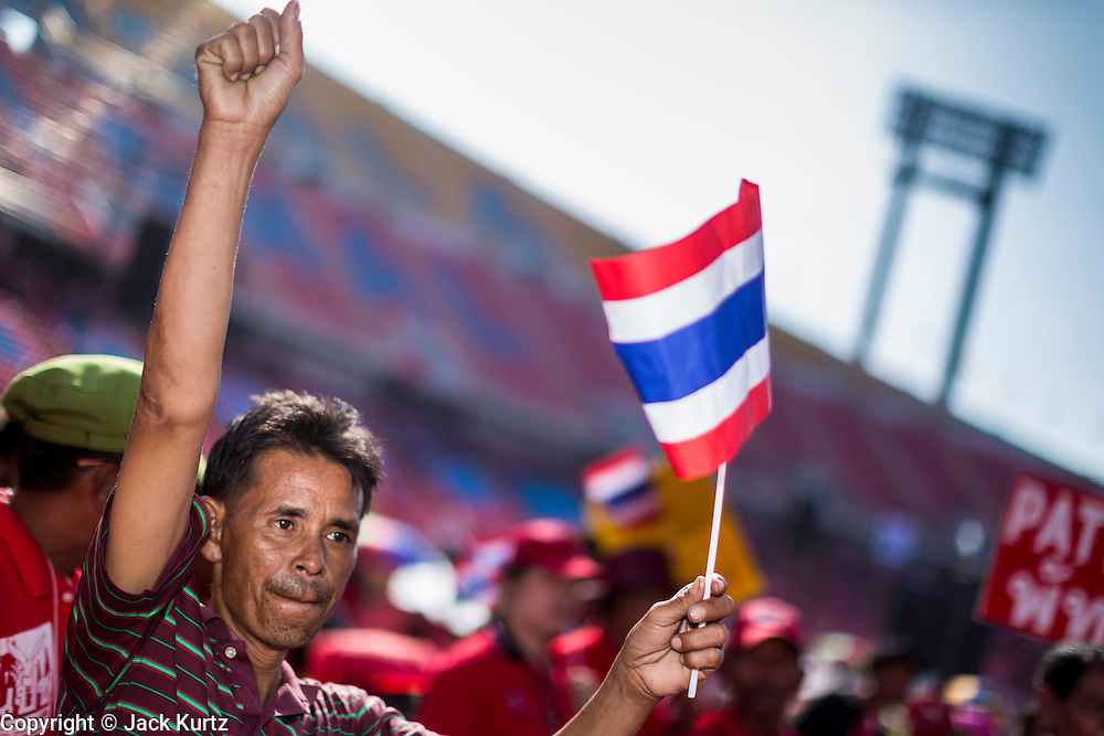 20 NOVEMBER 2013 - BANGKOK, THAILAND: Thai Red Shirts rally in support of the government Wednesday. Thousands of Red Shirts, supporters of the Pheu Thai ruling party in Thailand, gathered in Rajamangala Stadium in suburban Bangkok to listen to the Thai Constitutional Court deliver its verdict against the government. The court ruled that the recent efforts by the government to pass a blanket amnesty bill violated the Thai Constitution but the court did not order the party to disband or the dissolution of the government, which had been widely feared.     PHOTO BY JACK KURTZ