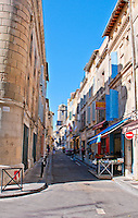 Looking up at a blue sky in a street in the historic city of Arles, France.