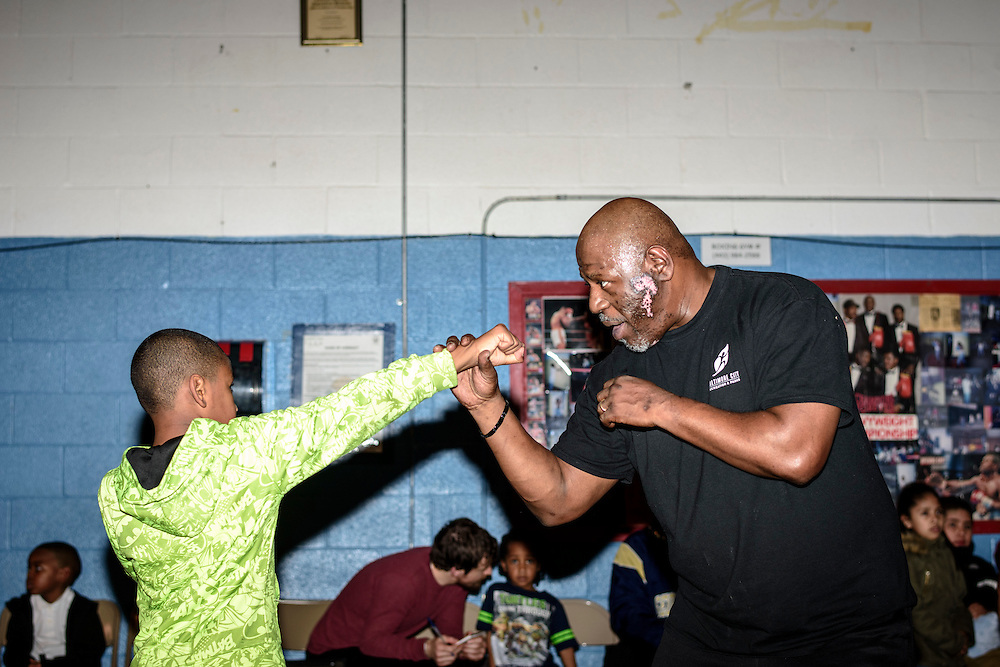Baltimore, Maryland - January 26, 2017: Coach Rodney C. Hunt works with a young boxer at the Upton Boxing Club in Baltimore Thursday January 26, 2017.<br /> <br /> <br /> CREDIT: Matt Roth for The New York Times<br /> Assignment ID: