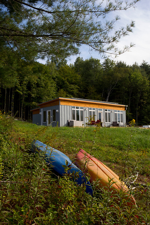 Because the building's wiring and plumbing is done at Vermod Home's Wilder, Vt., facility, the owners of a 1,500 square-foot modular home in Woodstock, Vt., were able to move in quickly after the net zero home's three pieces were placed on the foundation. (Photo by Geoff Hansen)