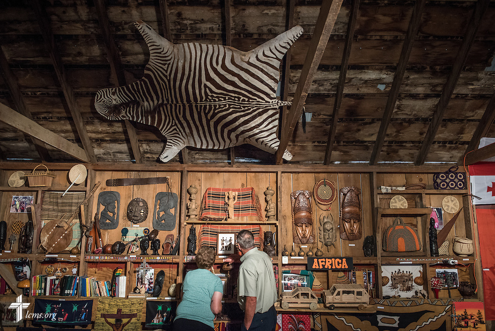Visitors to the sanctuary and mission museum browse artifacts before worship at Mission Central on Sunday, July 19, 2015, in Mapleton, Iowa. LCMS Communications/Erik M. Lunsford